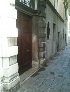 """When you can get to the right street, search for big wooden doors and a doorbell with the text """"Residenza Ca' Zanardi."""""""